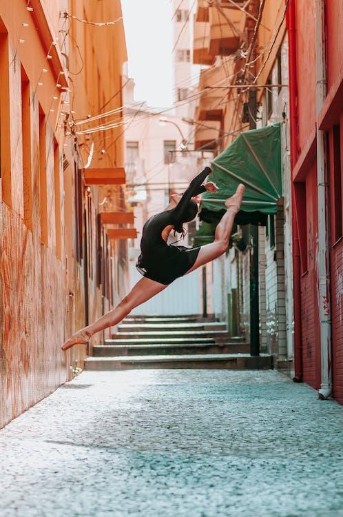 Woman Doing Ballet Dance in Pathway