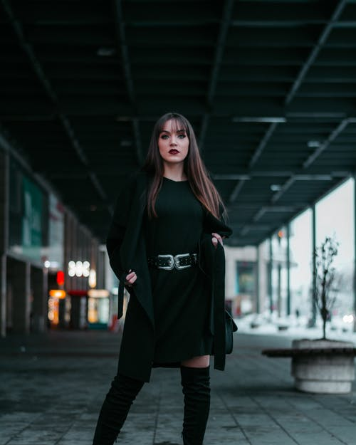 Standing Woman Wearing Black Crew-neck Dress and Cardigan