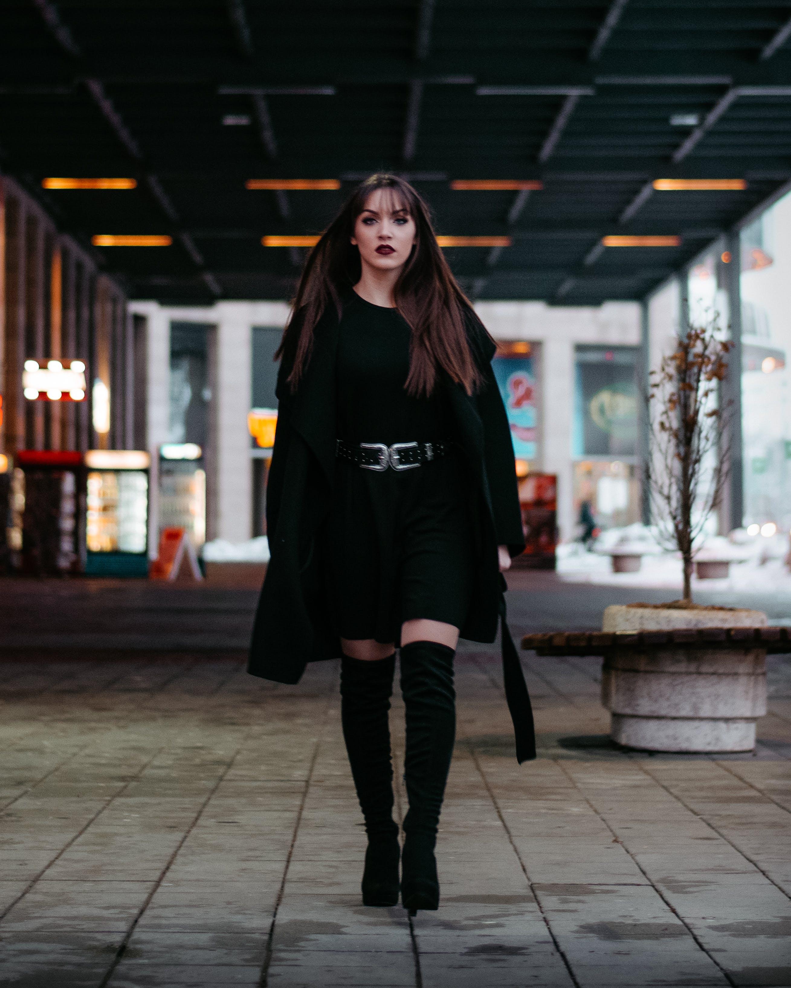 Woman Walking Alone on Pathway