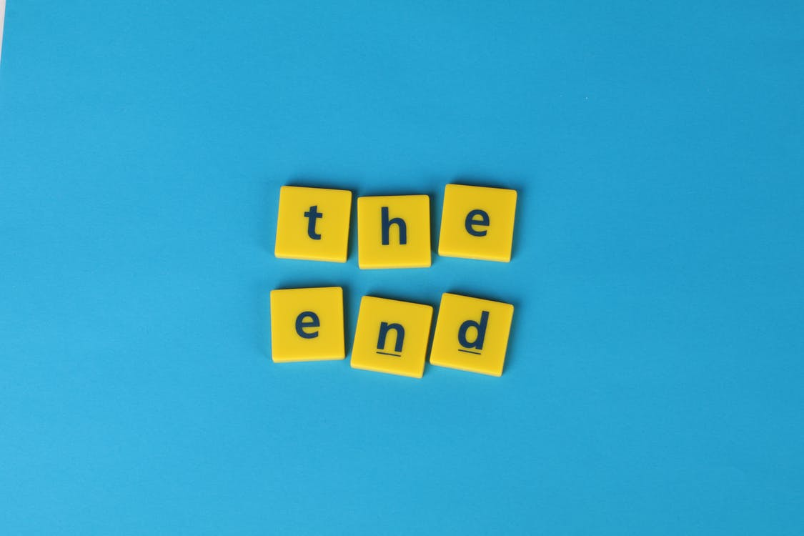 """Letters On Yellow Tiles Forming """"The End"""" Text"""
