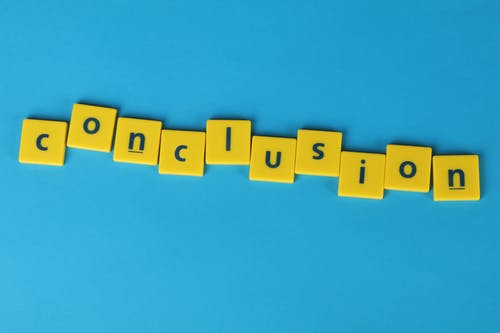 """Conclusion"" Word Formed From Lettered Yellow Tiles"