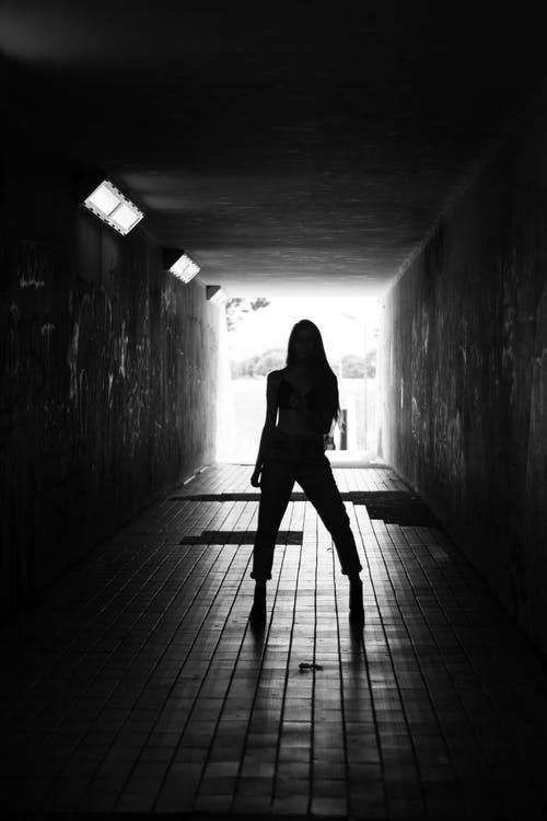 Silhouette Of Woman Standing On Hallway