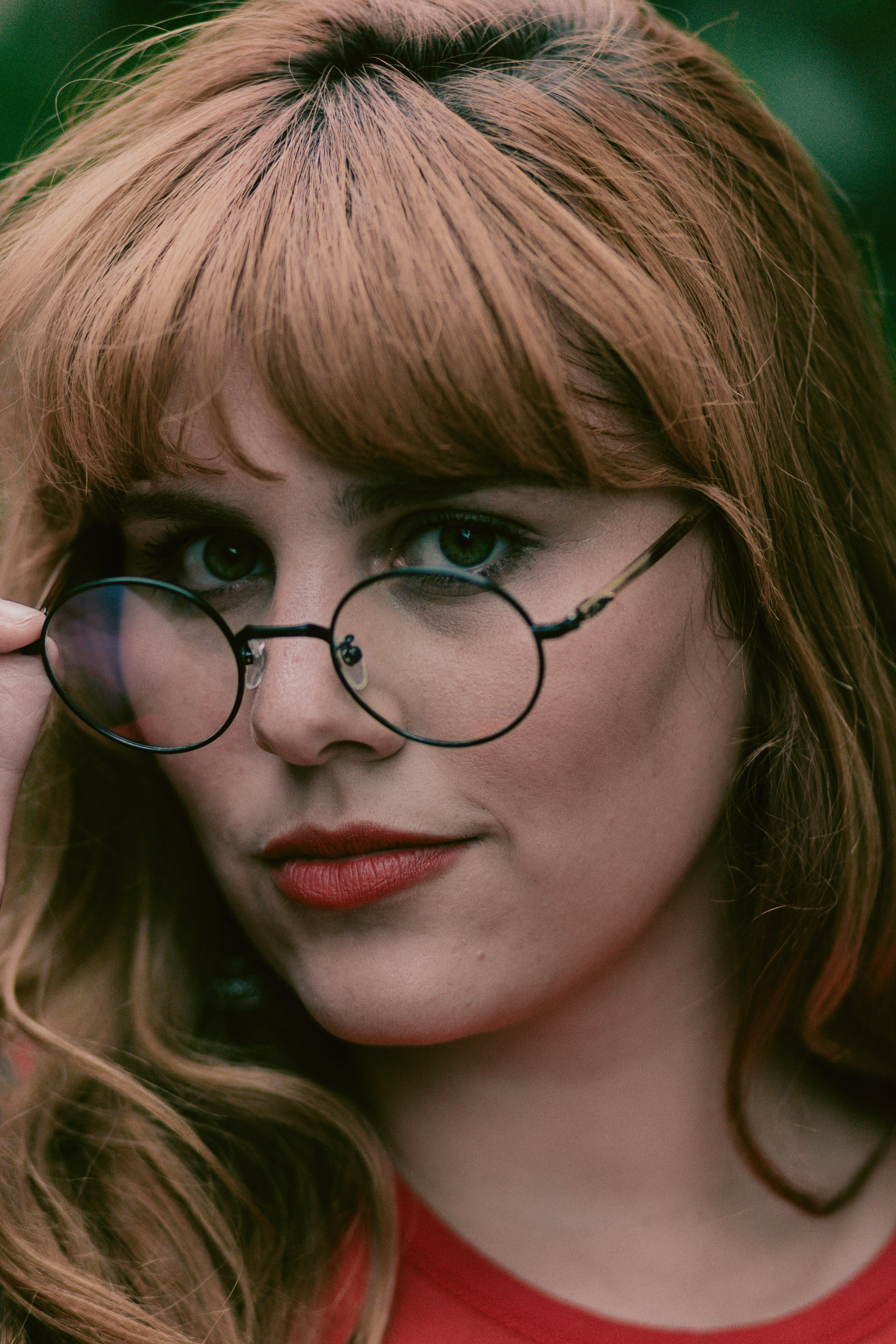 Close-up Photo of Woman in Eyeglasses