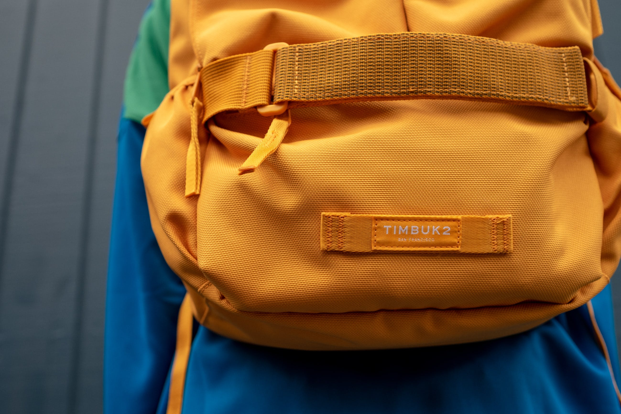 Close-up Photo of Orange Timbuk2 Backpack on Persons Back