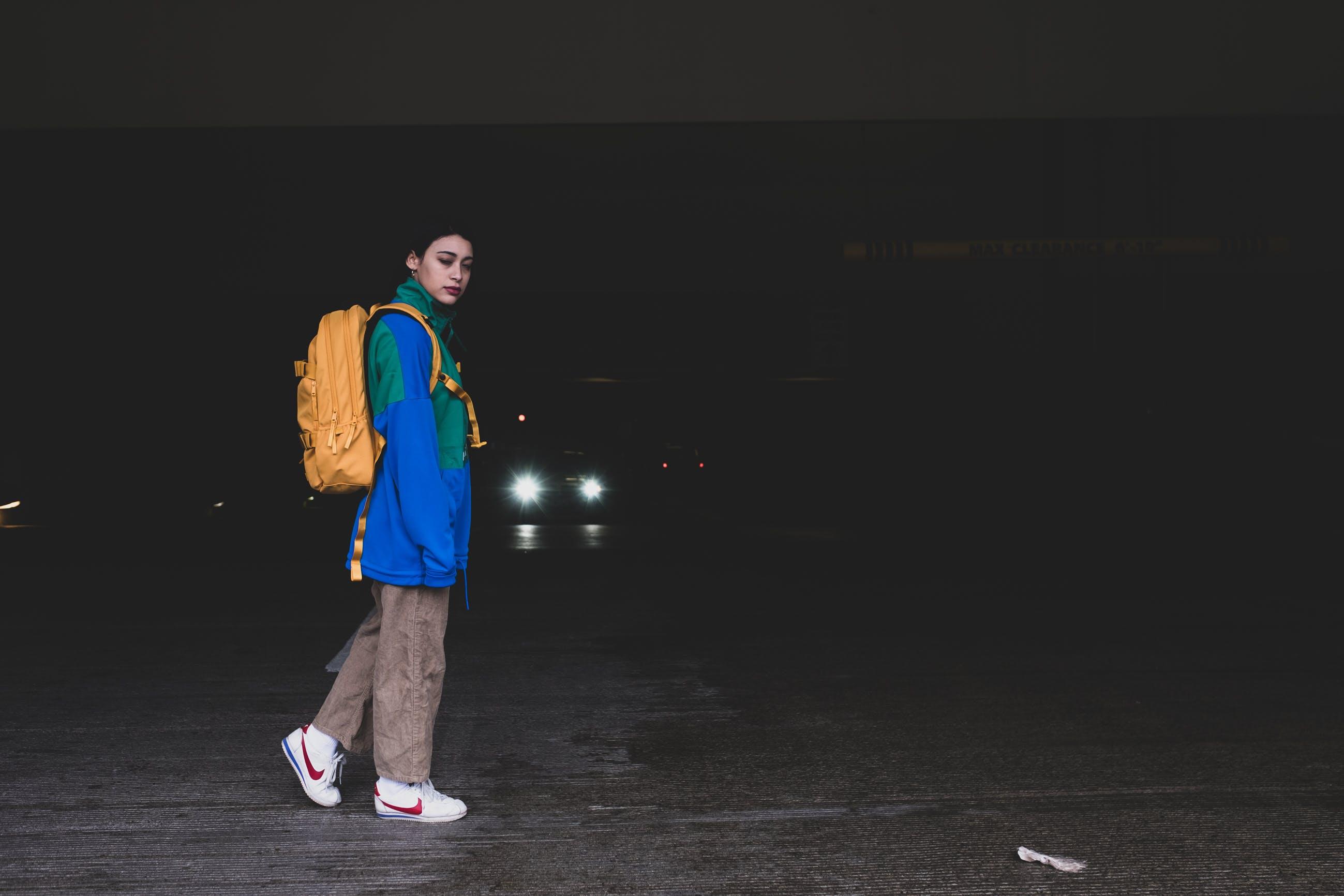 Woman Wearing Yellow Backpack