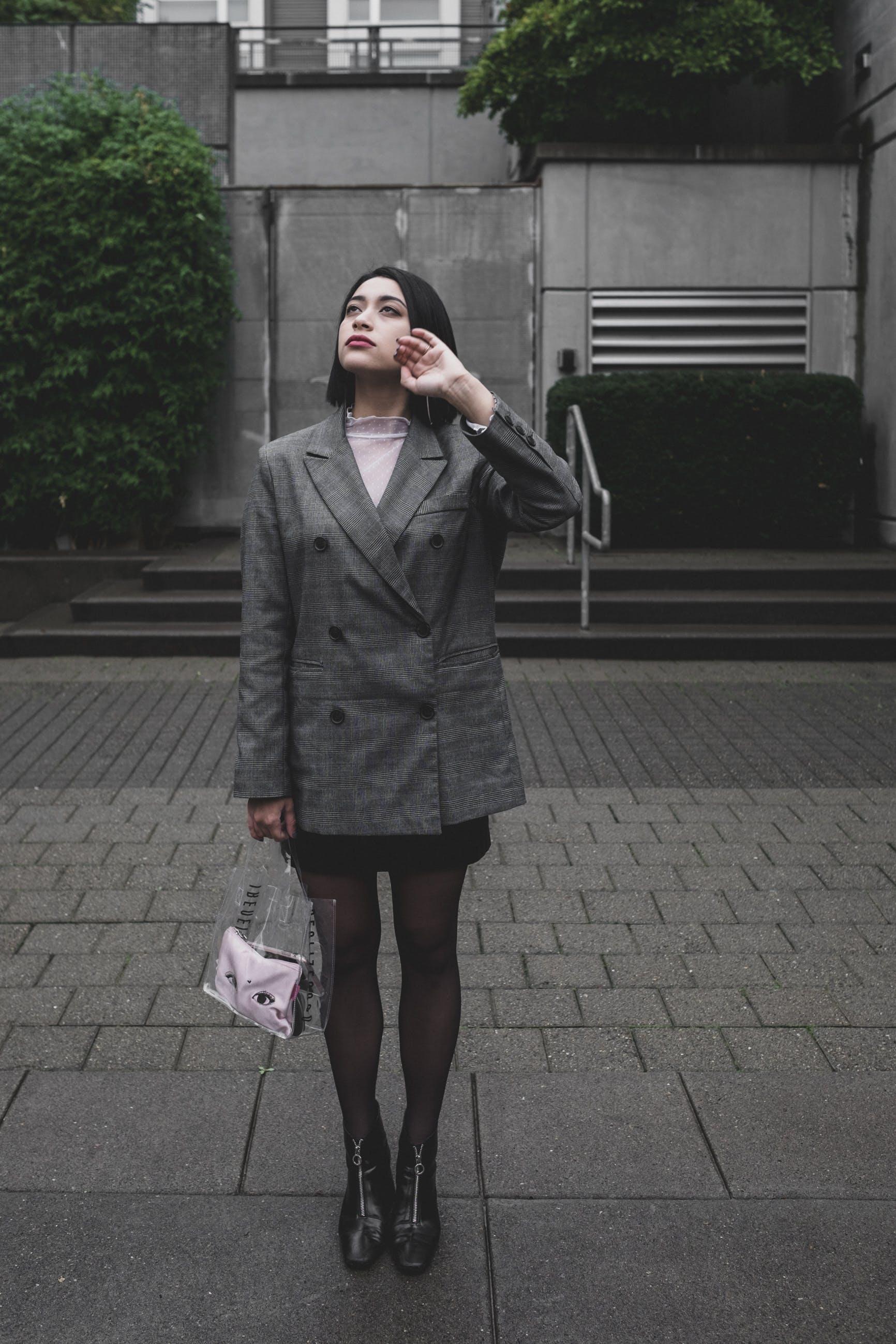 Woman Standing on Gray Pavement Wearing Gray Coat