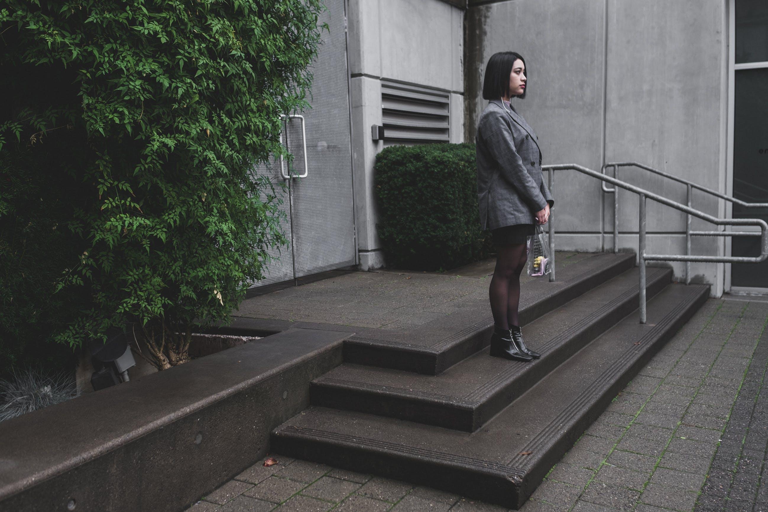 Woman Wearing Blazer Standing Near Green Plant