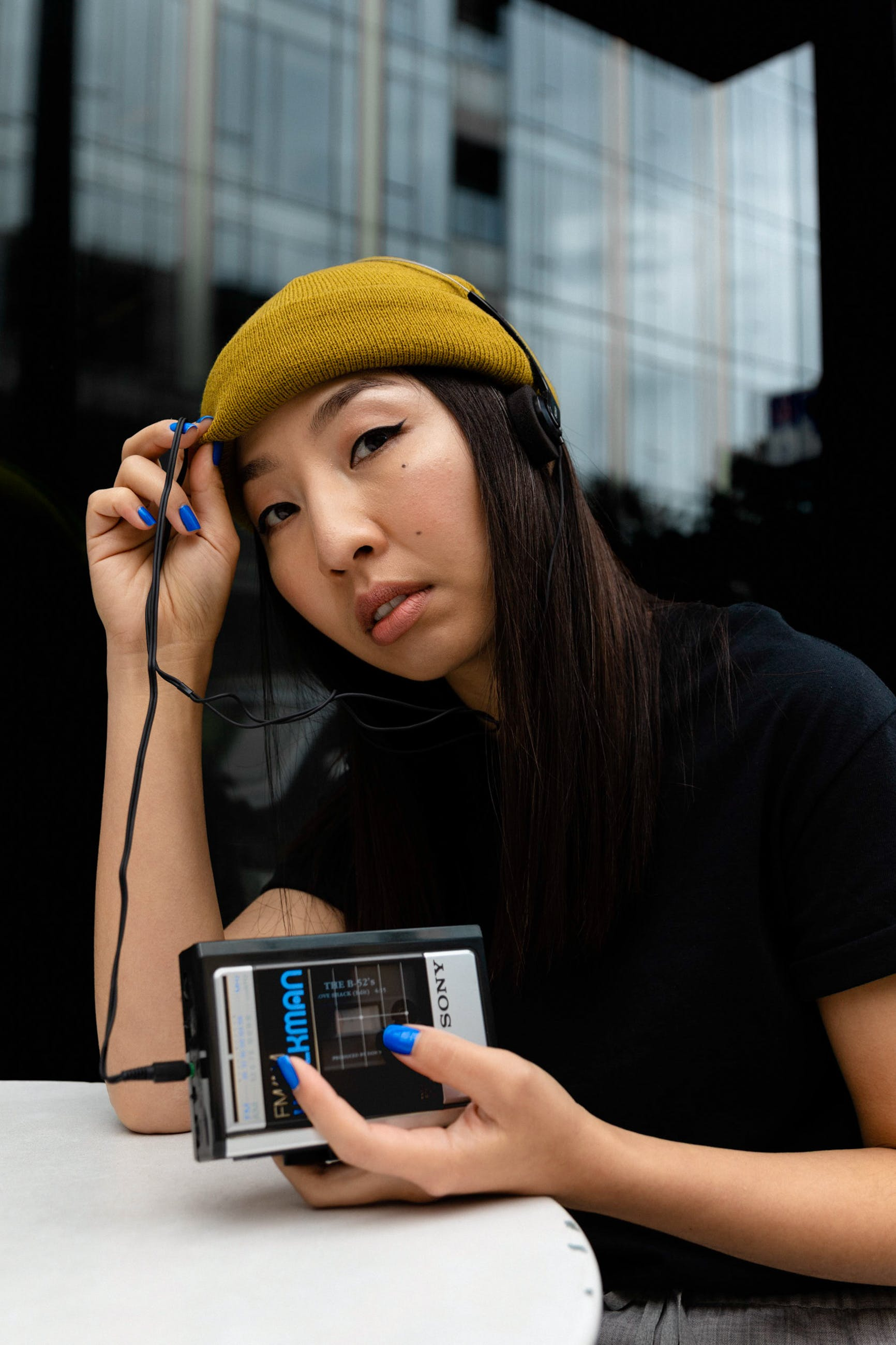 Woman Sitting and Using Sony Walkman Portable Music Player