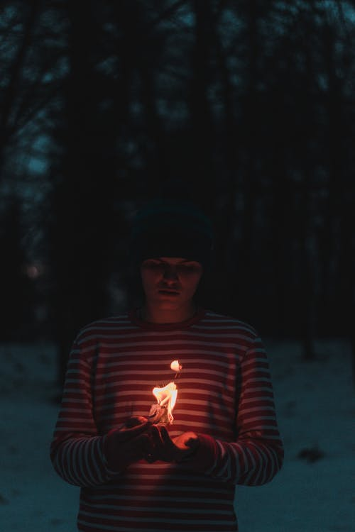 Person Wearing Striped Sweater