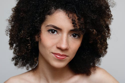Portrait Photo of Curly-Haired Woman