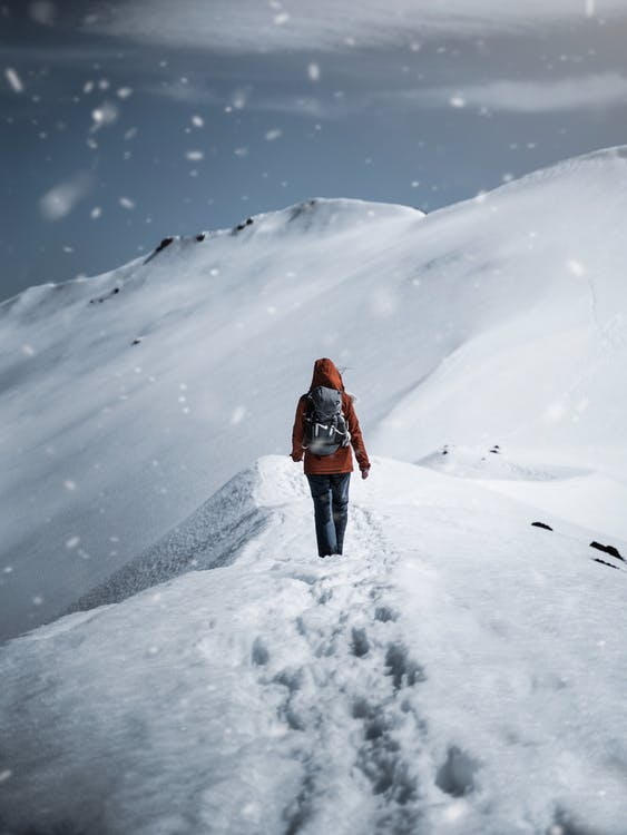 Person Walking on Snow