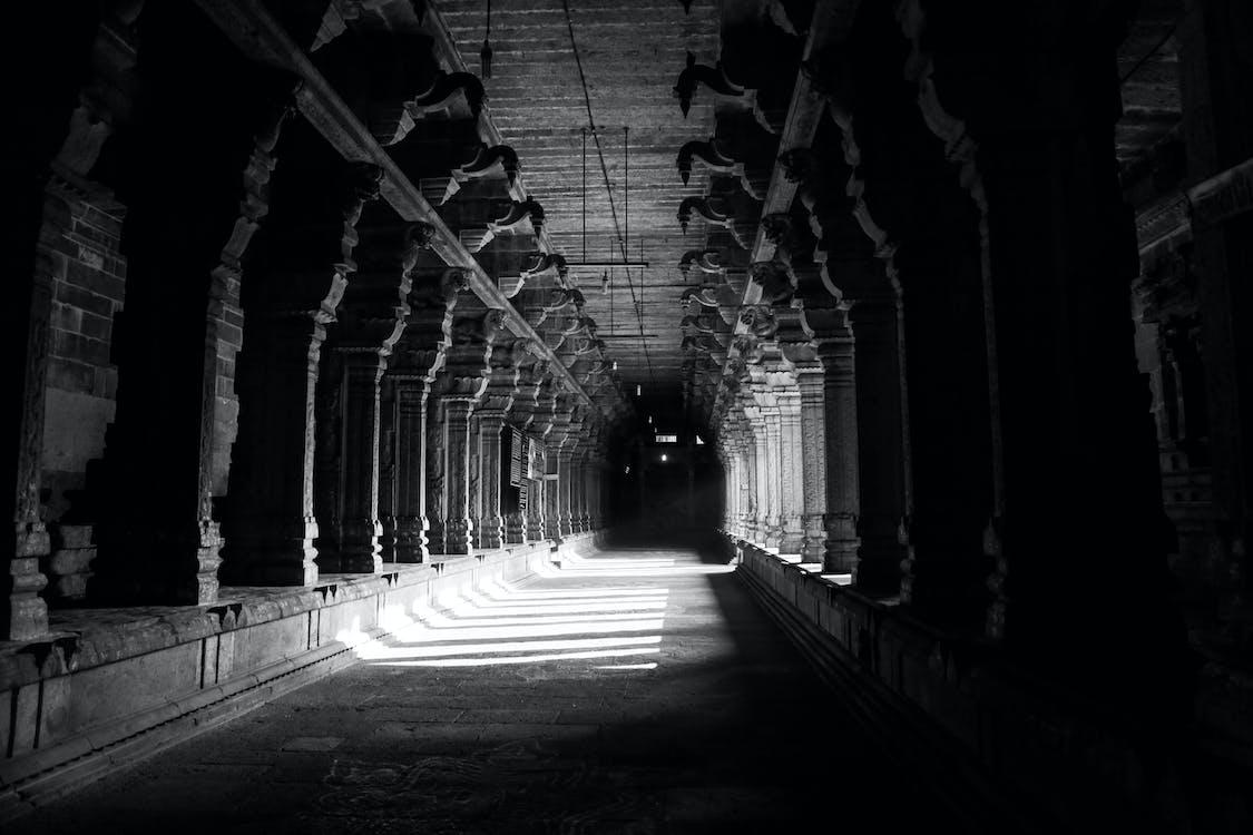 Grayscale Photo of Hallway