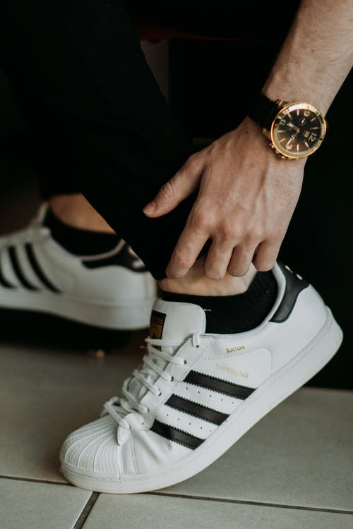Person Wearing Adidas Superstar