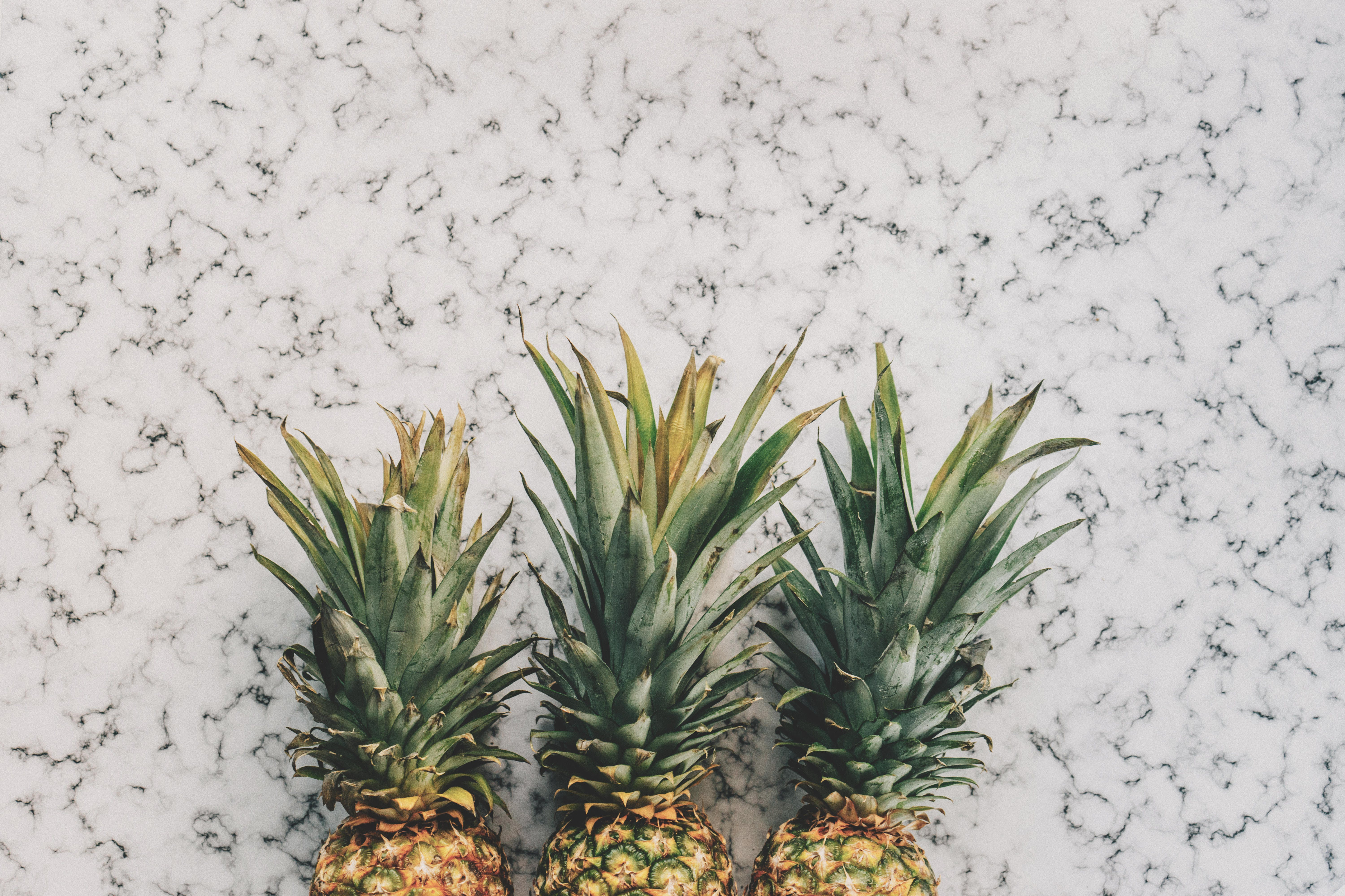 3 Pineapple Fruit on White and Grey Sand