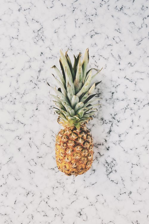 Pineapple on Top of White Surface