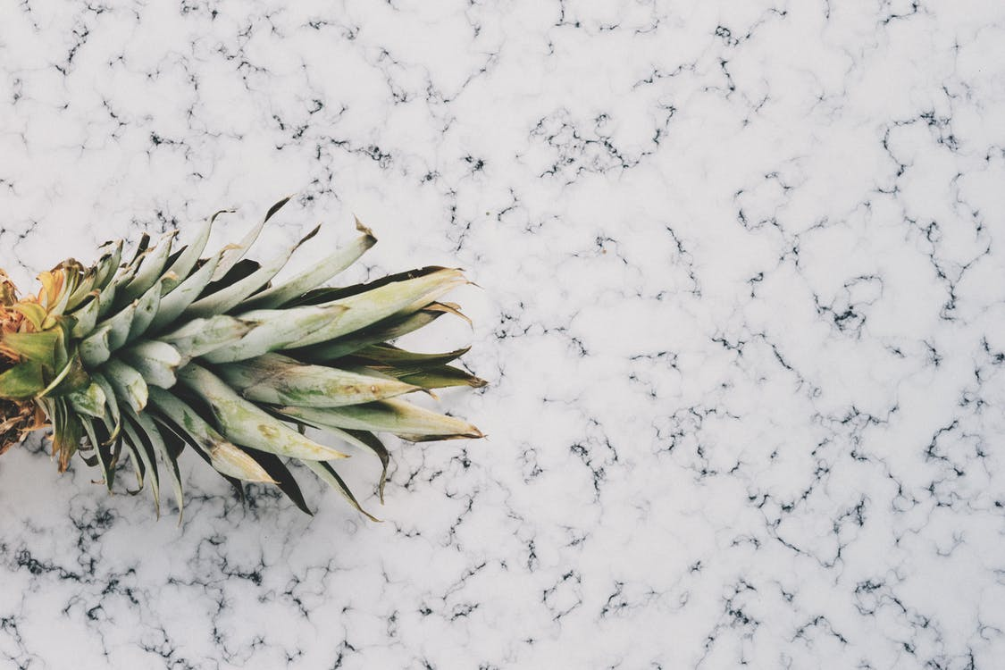 Close-up Photo of Ripe Pineapple Fruit on Marble Surface