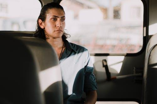 Man Wearing Shirt Sitting Inside Vehicle