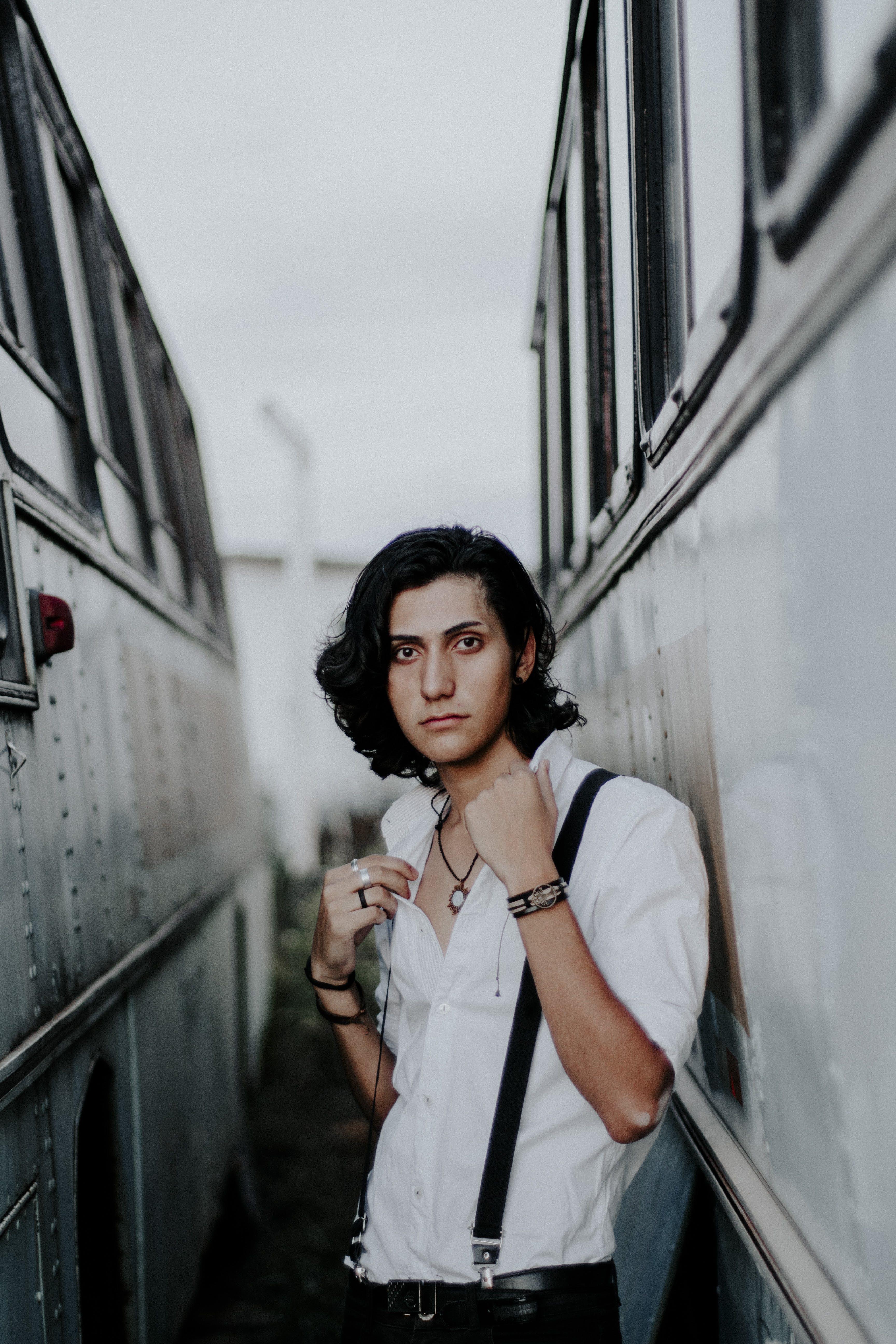 Man Standing Between on Bus