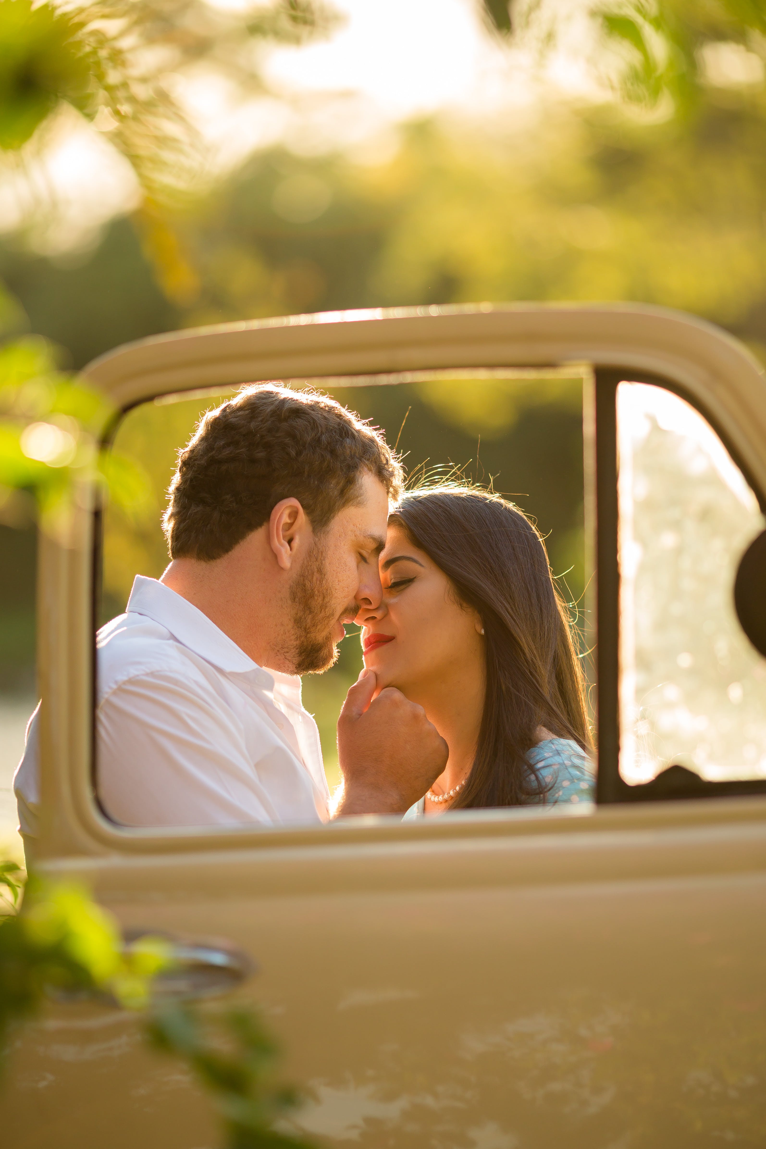 Selective Focus Photography of Couple Trying to Kiss