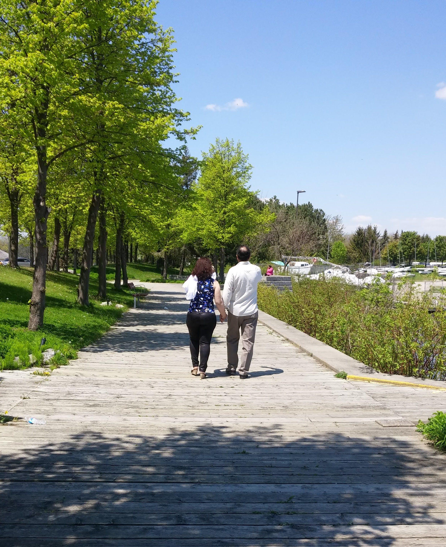 Free stock photo of couple walking, park, park walk, trail walk