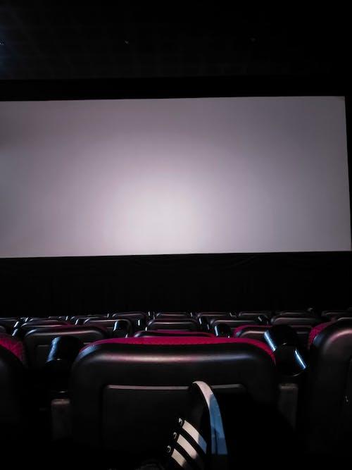 Foto stok gratis bioskop, gelap, kosong, lampu merah