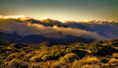 Ingyenes stockfotó felhők, hegy, naplemente témában
