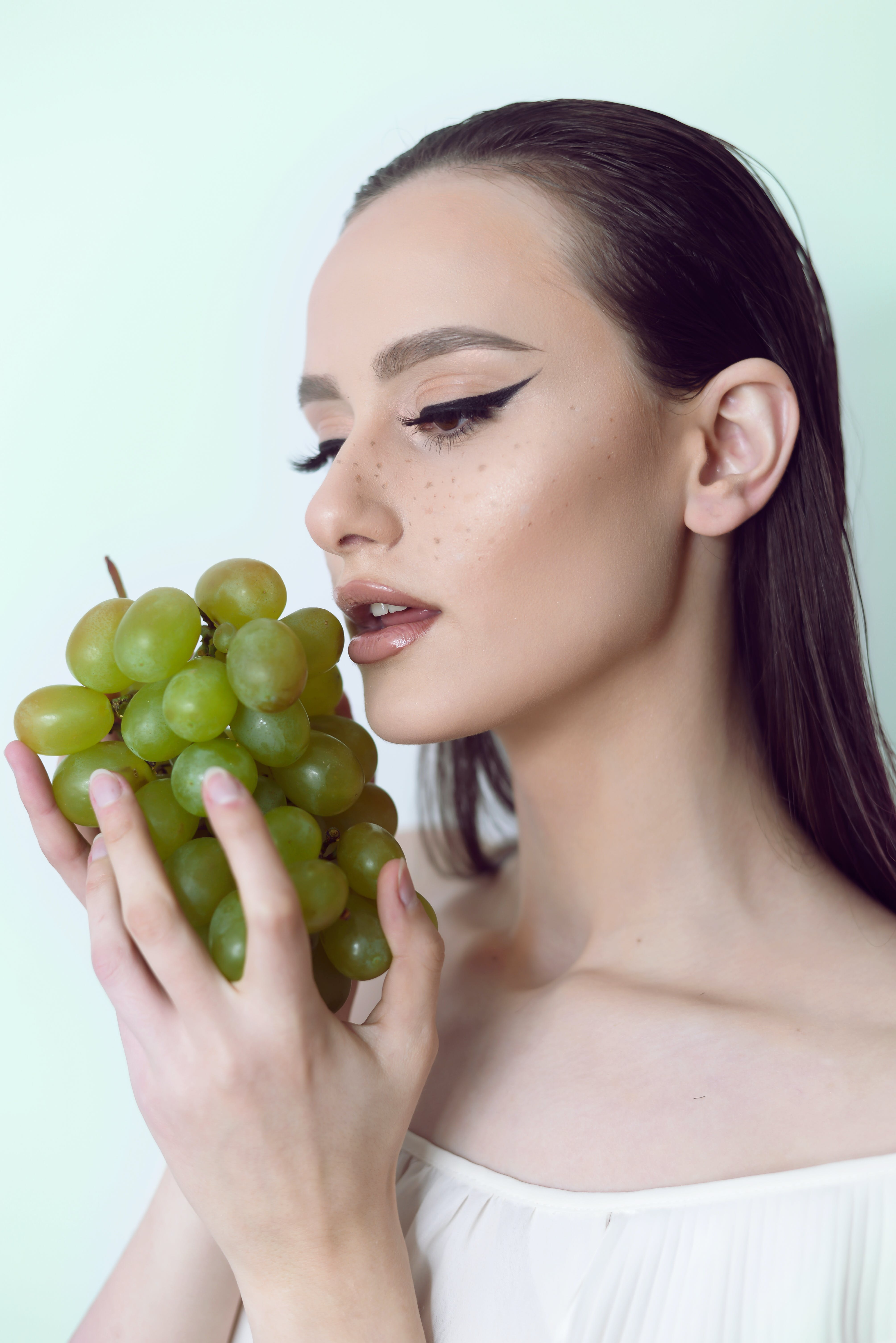 Photo of Woman About to Eat White Grapes