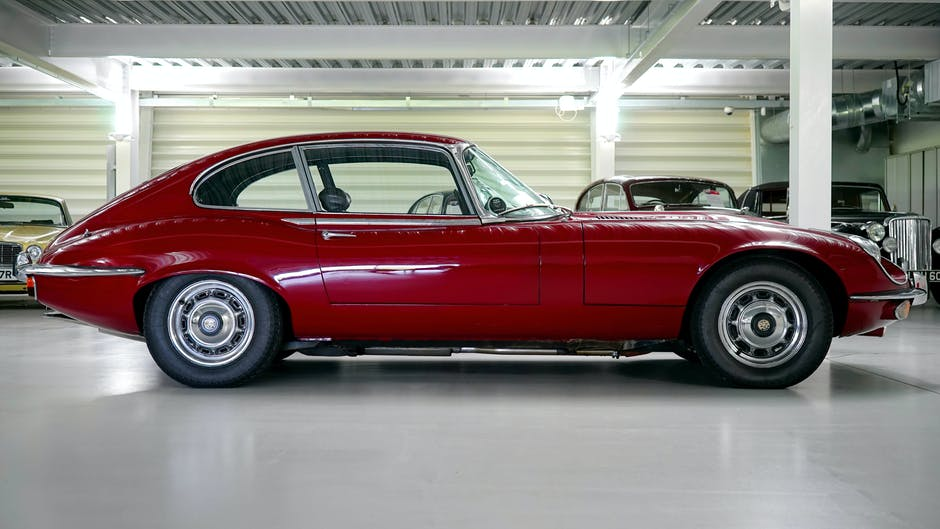 Black Red Classic Car in a Garage