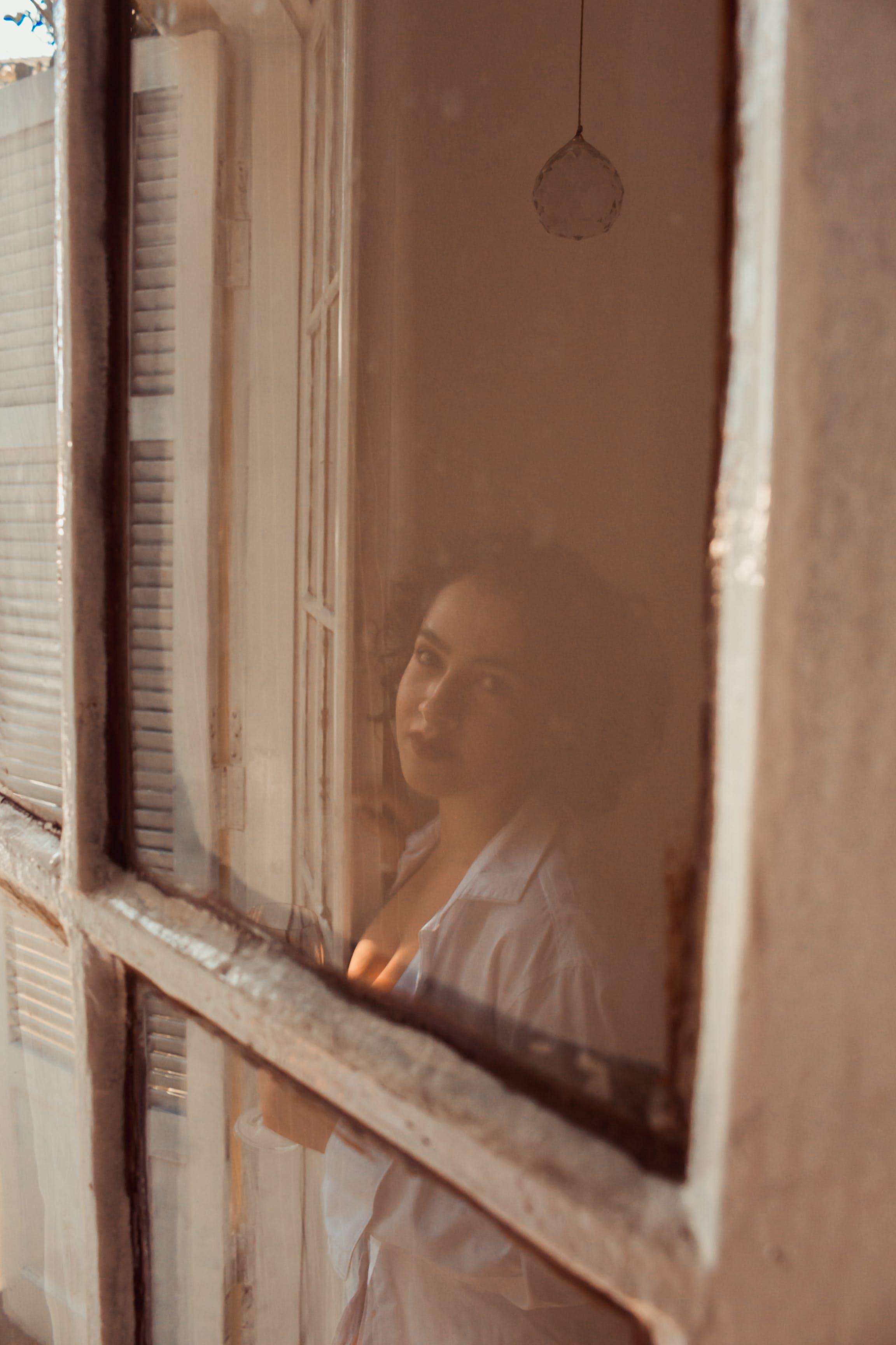 Woman Standing Near White Wooden Door