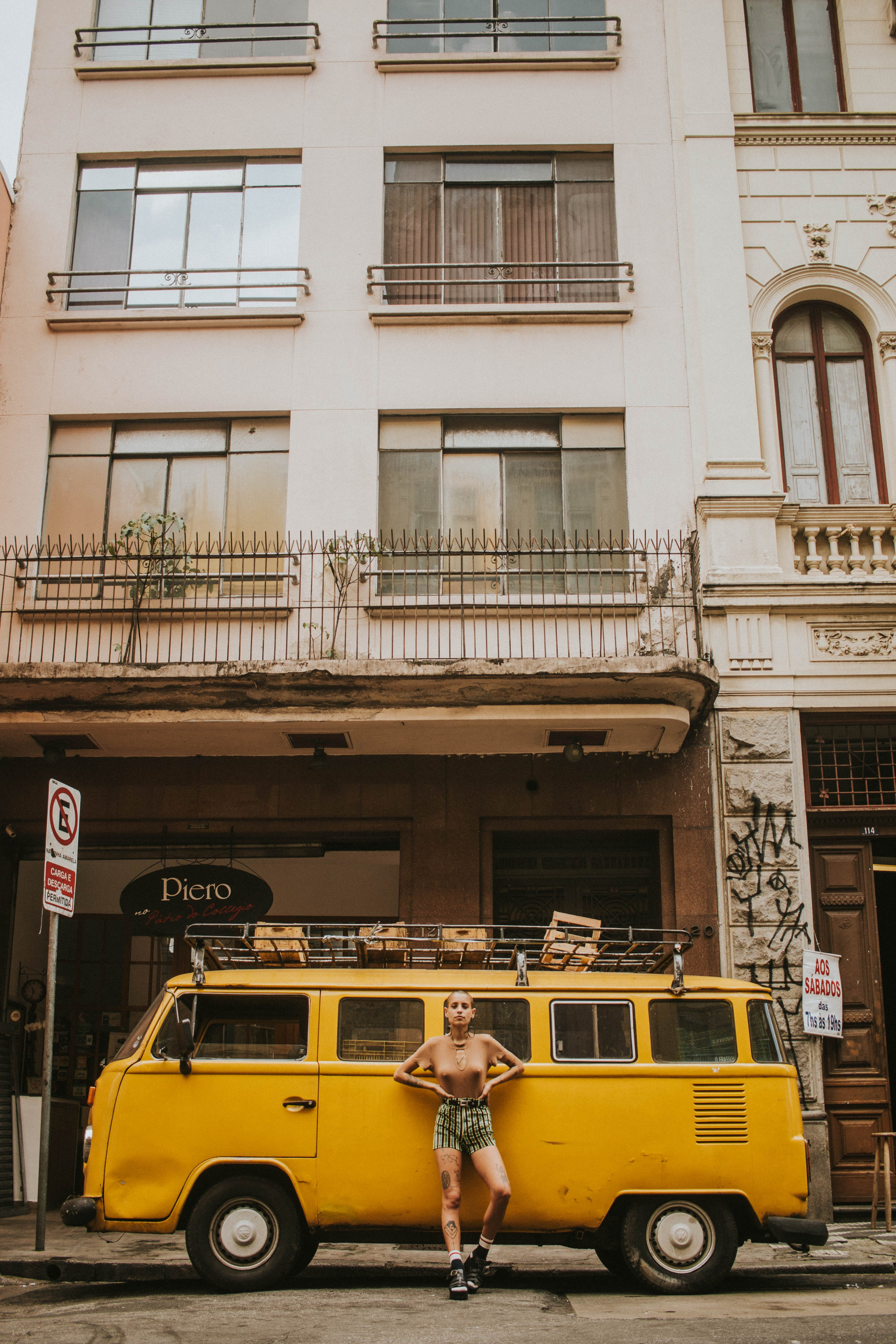 Woman Leaning on Yellow Bus