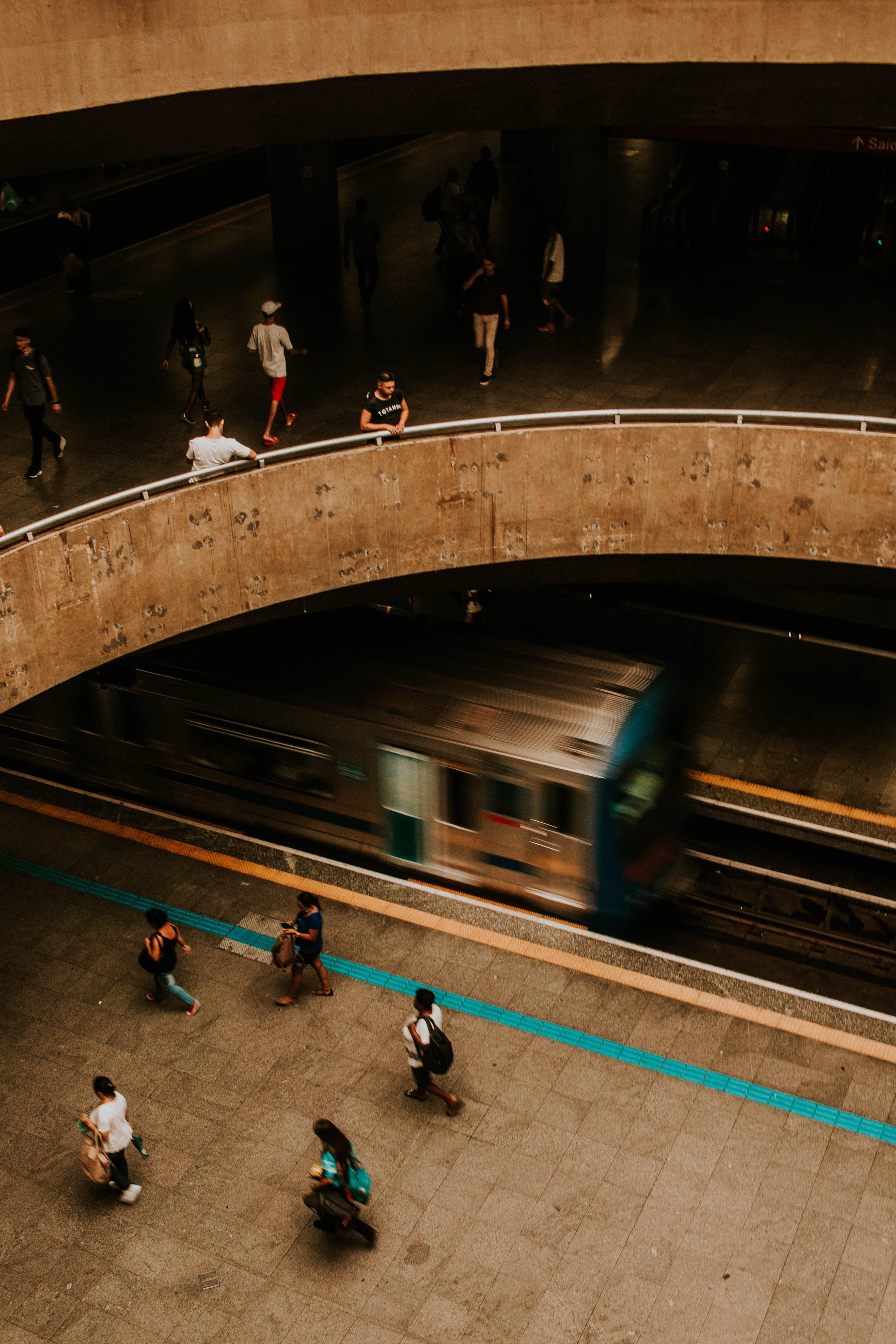 People Walking on Train Subway