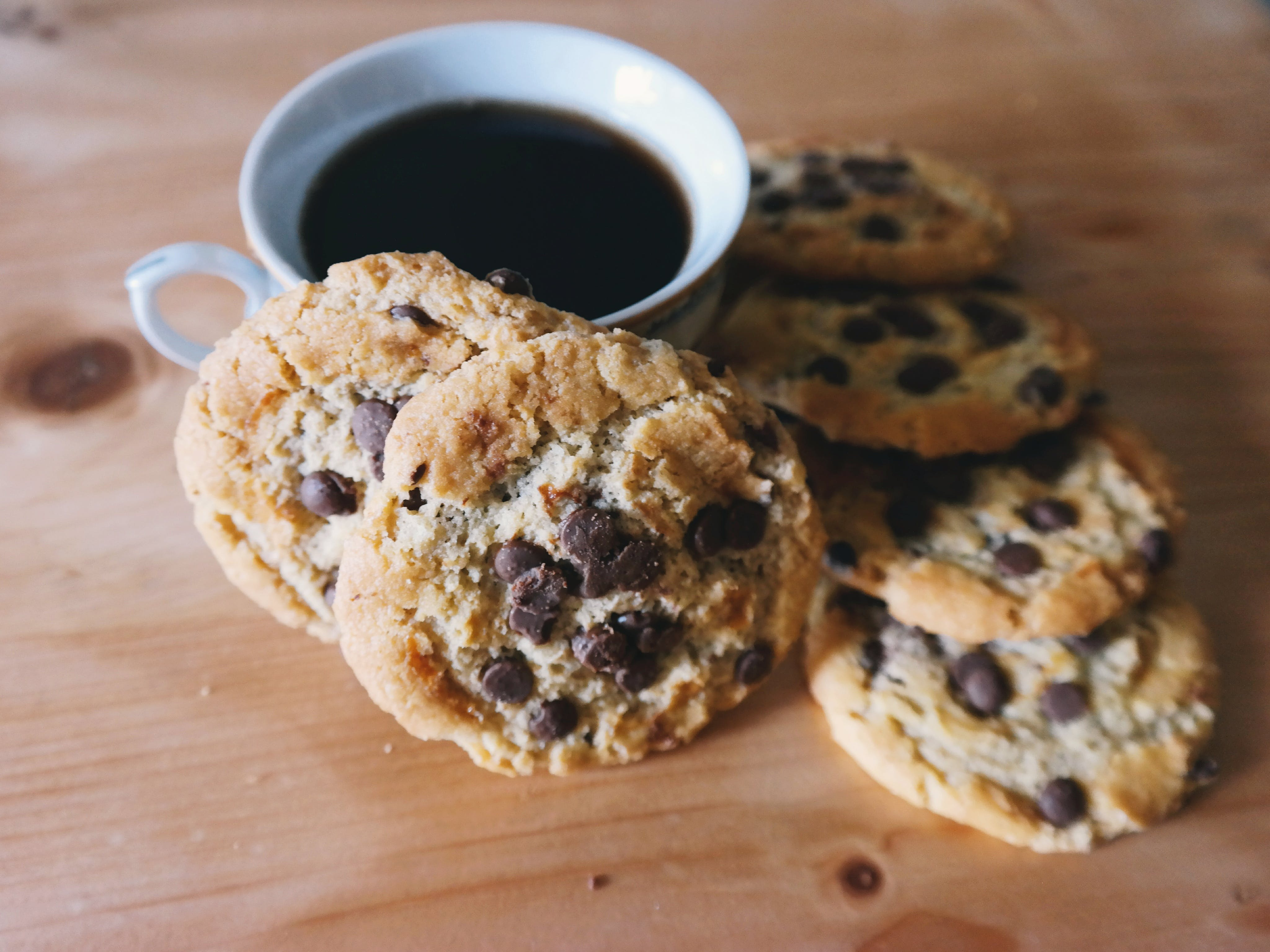 Cup of Coffee and Cookies on Table