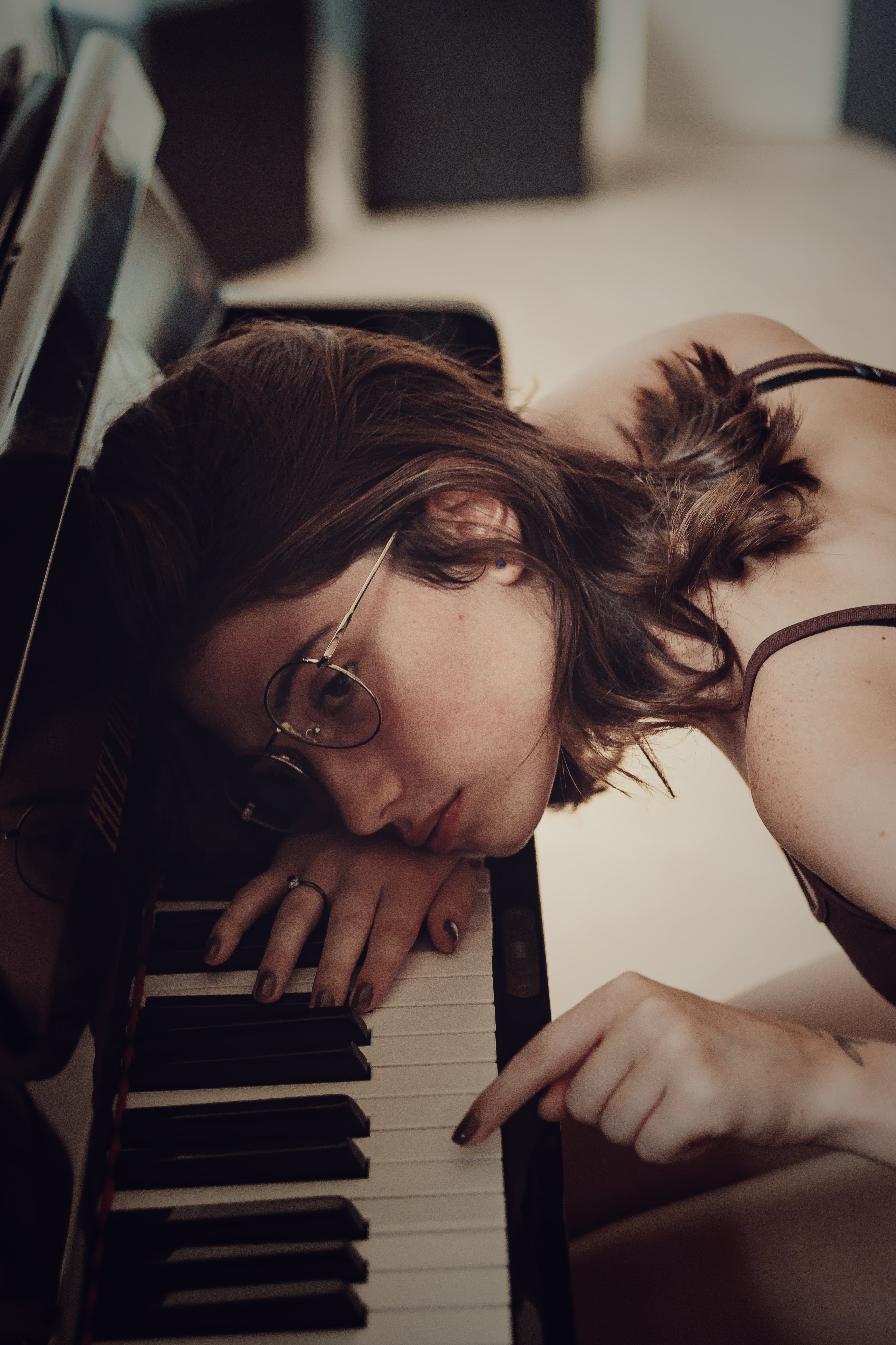Woman Leaning on Piano Keys