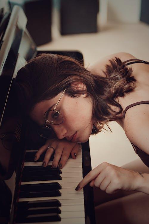 Woman Leaning on Piano Keys