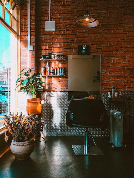 Salon Chair Beside Oil Heater in Front of Mirror Inside Room