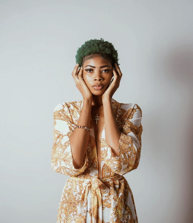 Photo of Standing Woman With Green Hair With Both Hands on Face
