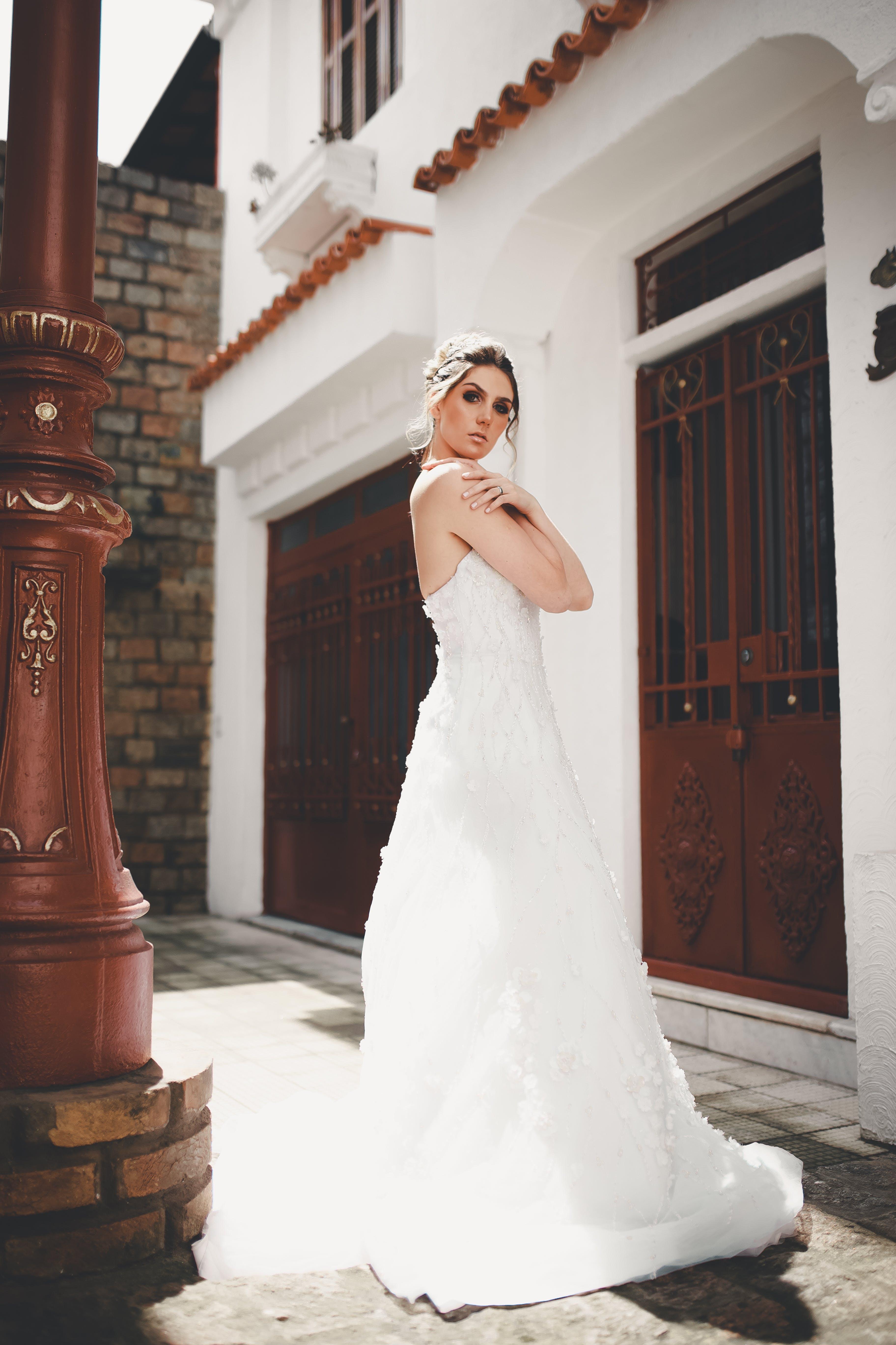 Woman Taking Pose in Her Wedding Dress