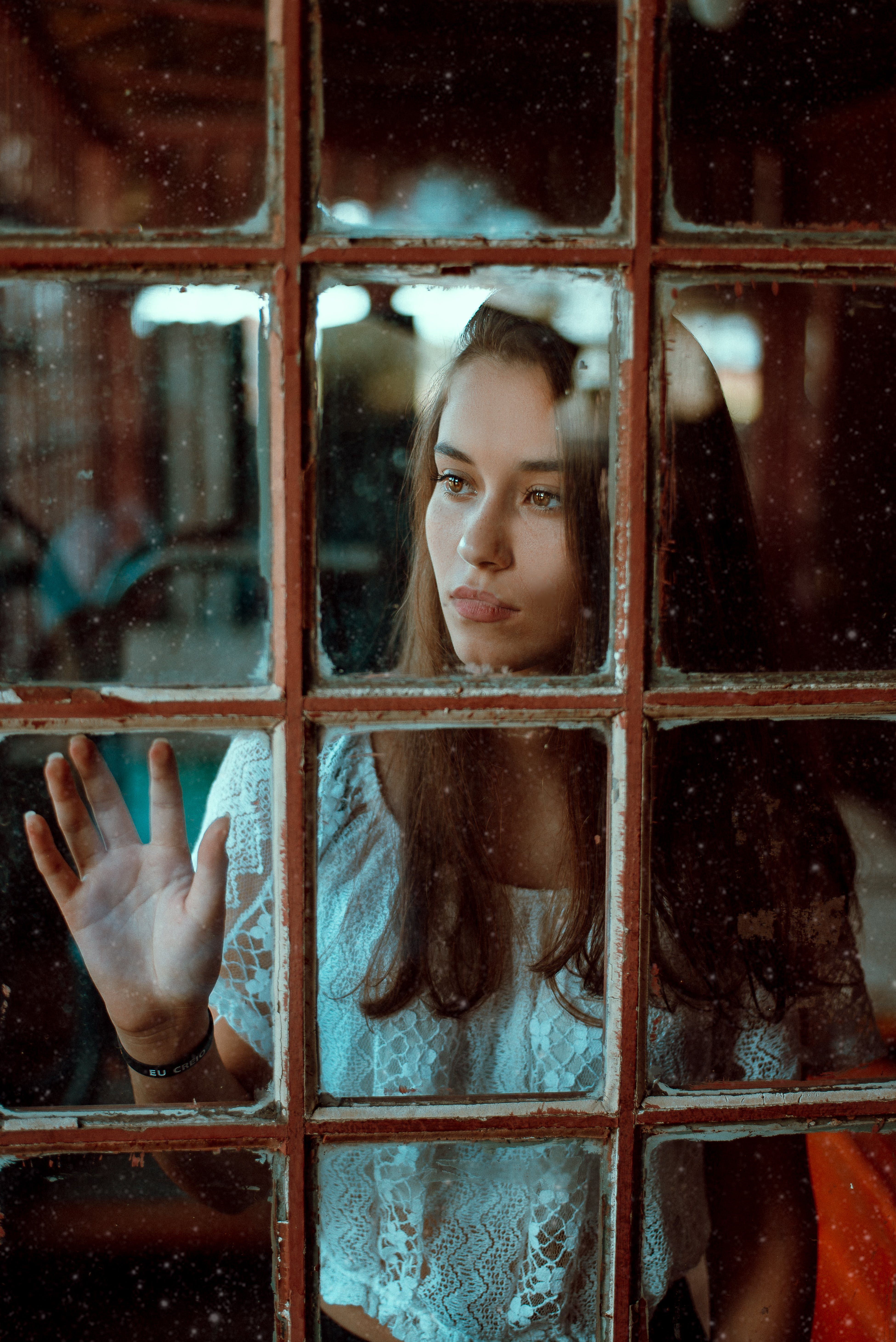 Woman Looking Through the Glass Window