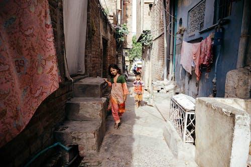 Two Kids Walking on Alley
