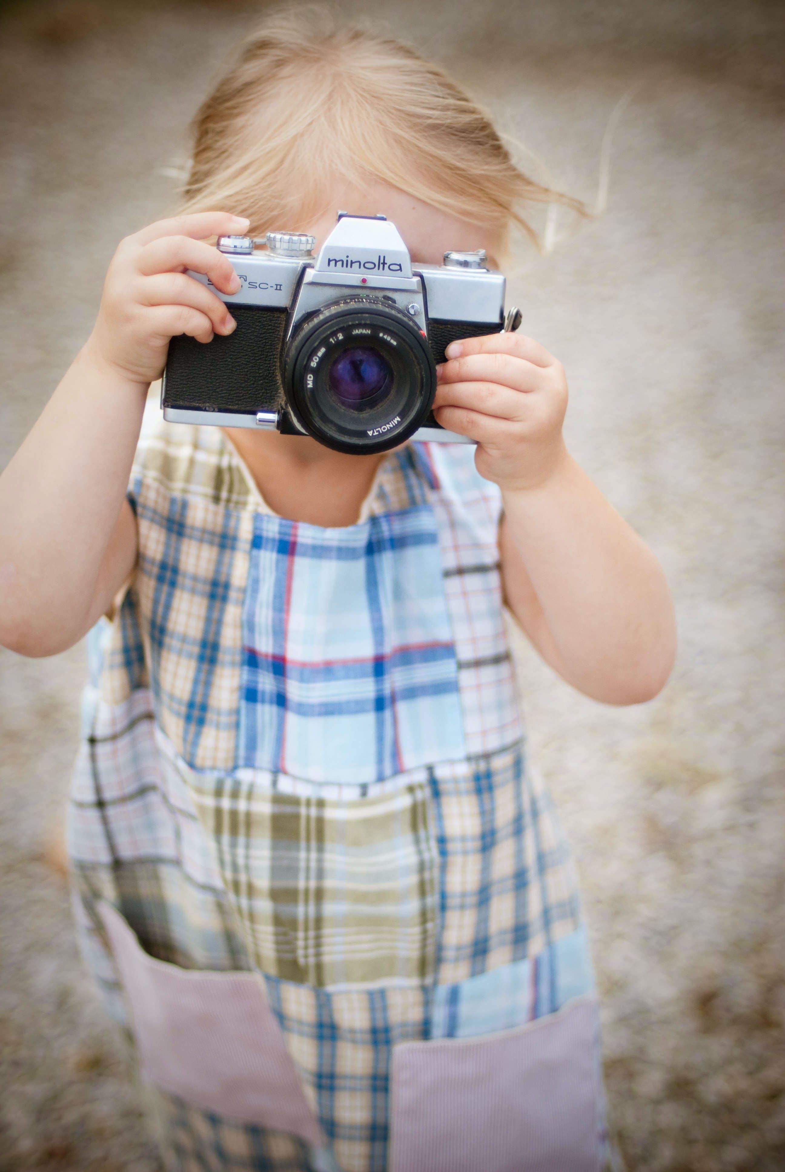 Toddler's Taking Photo