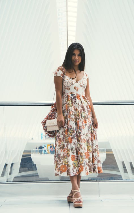 Woman Wearing Orange and White Floral V-neck Cap-sleeved Maxi Dress