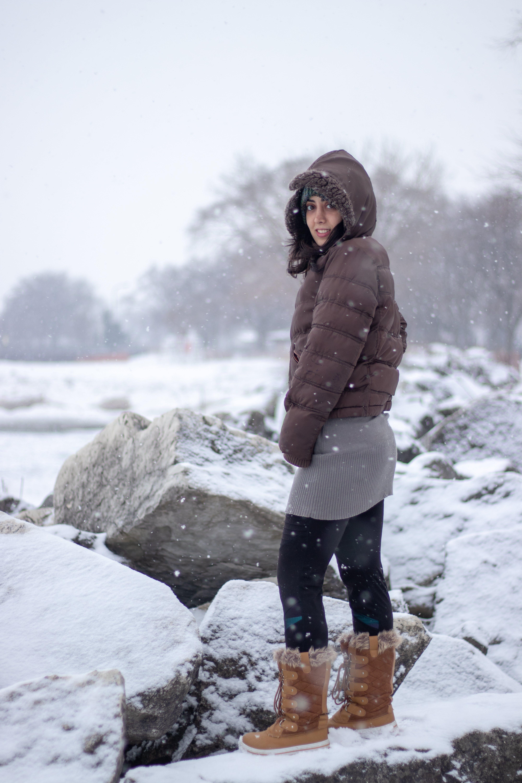 Free stock photo of girl, rocks, snow, winter