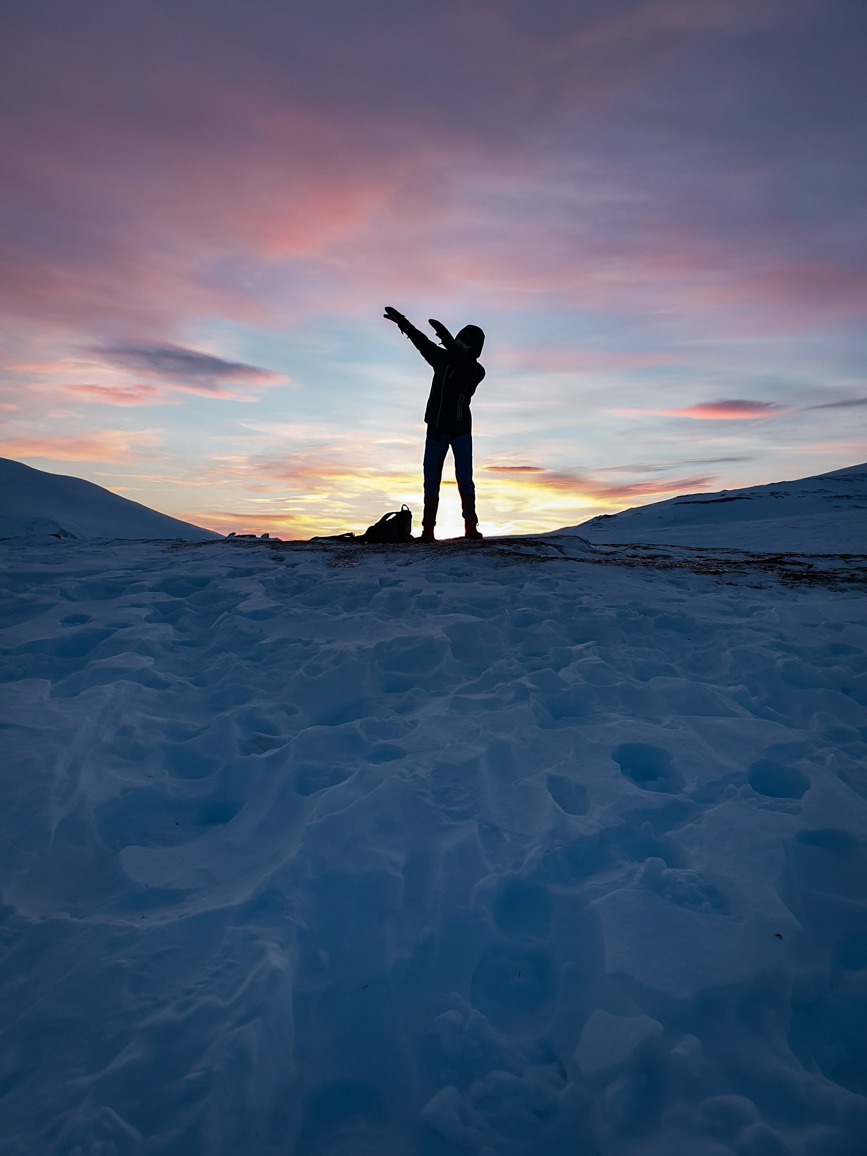 Silhouette Of Person Standing On Snow