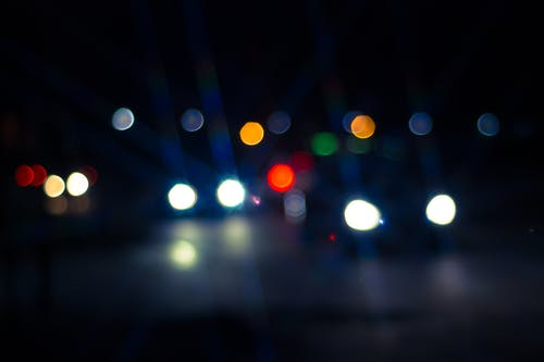 Photo of Car and Street Lights during Night Ime