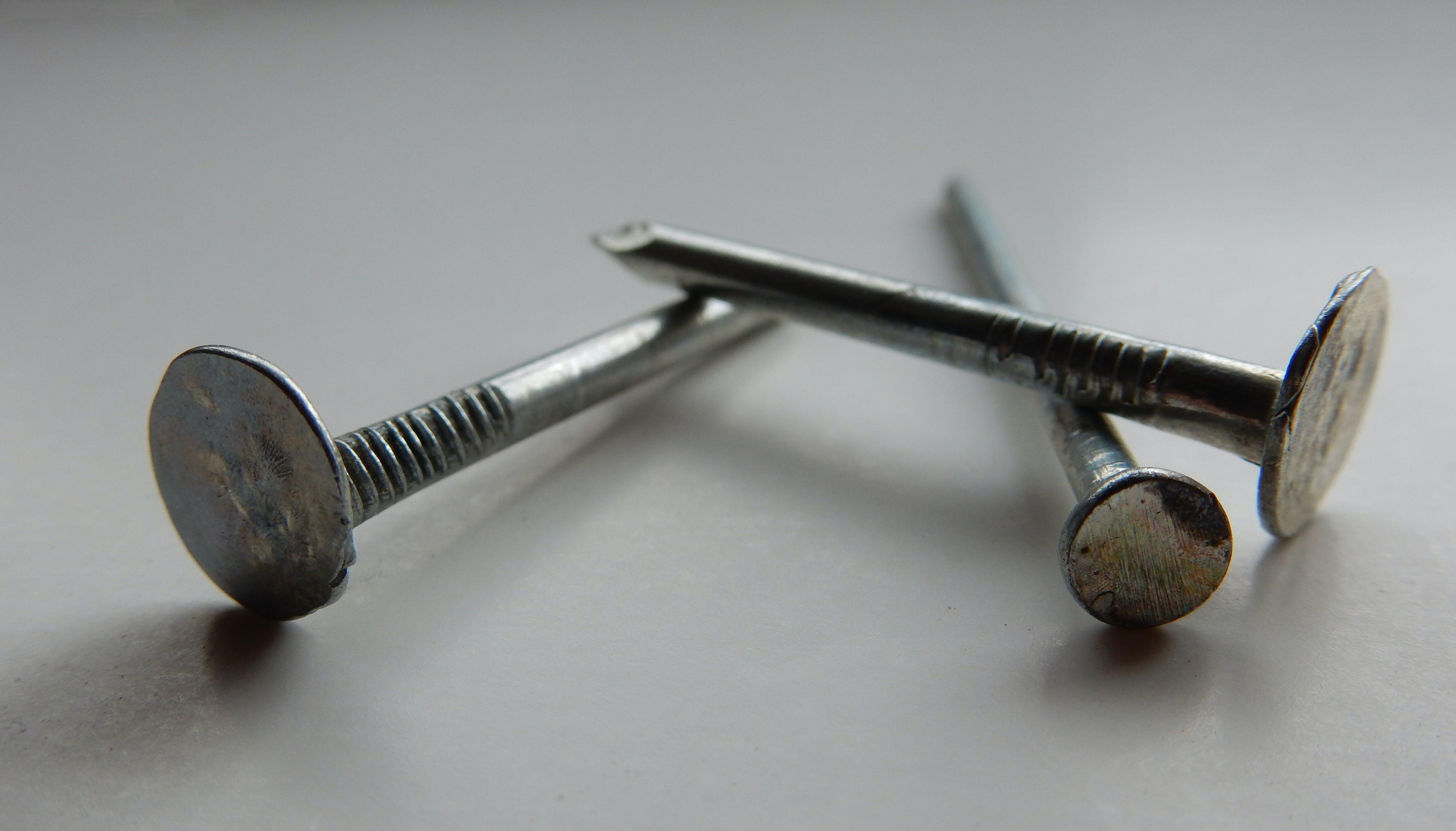 3 Flat Head Nails Close Up Photography