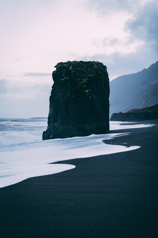 Black Rock Formation Near Sea