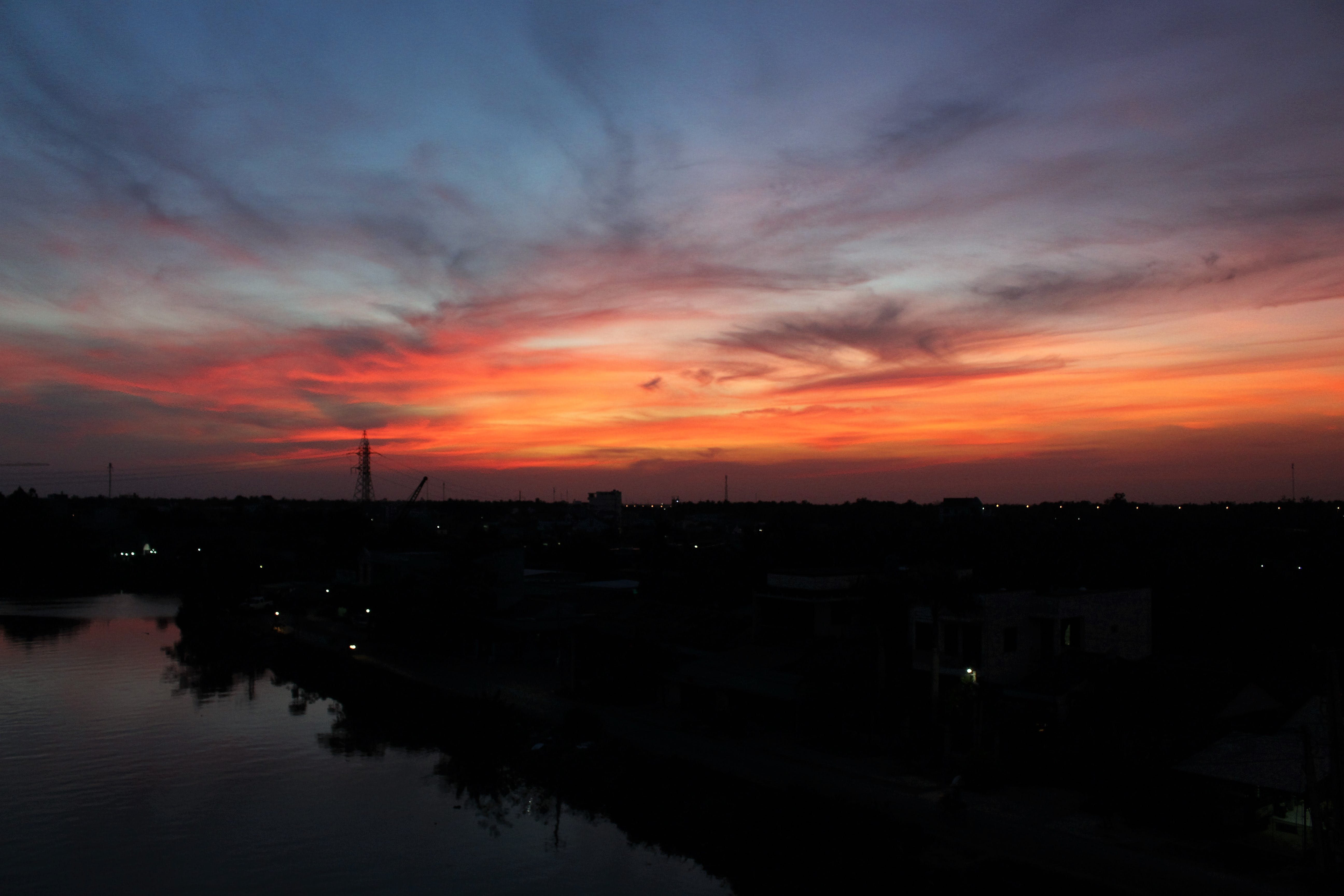 Silhouette Photo of Skyline Building Below Orange and Blue Sky