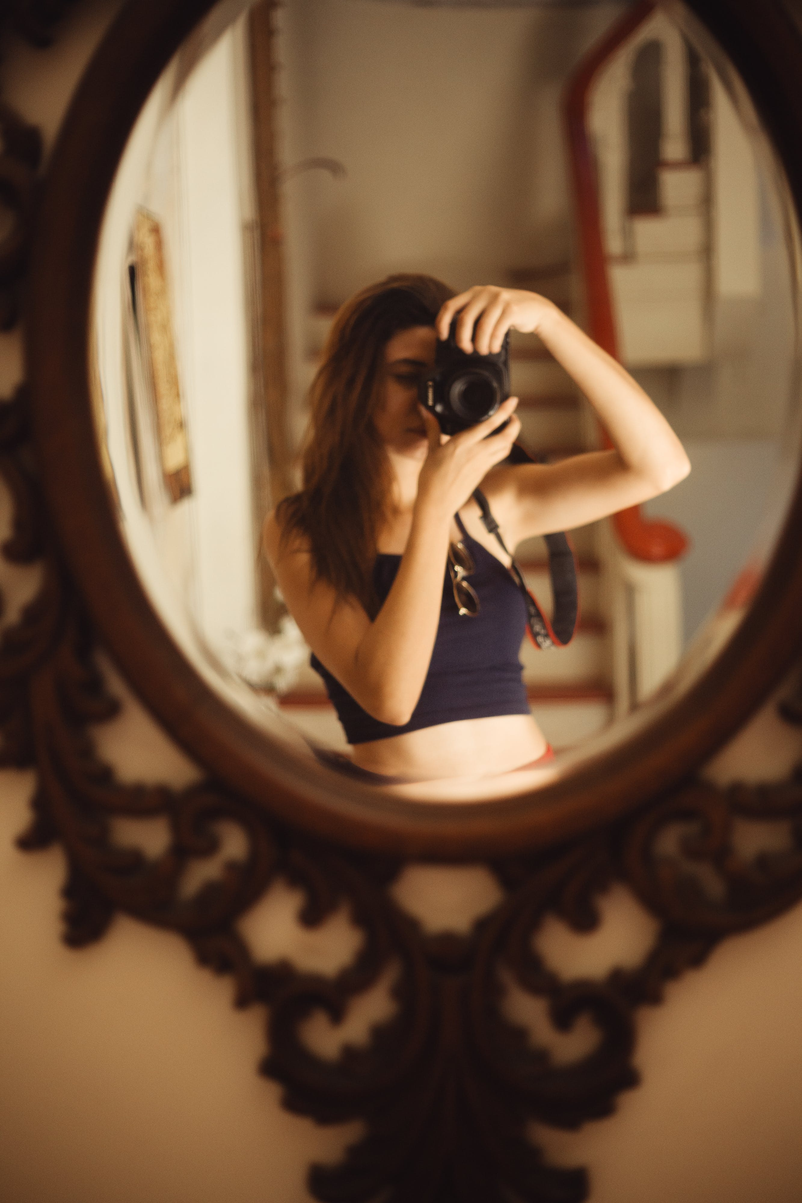 Woman Taking Selfie in Front of Mirror Using Dslr Camera