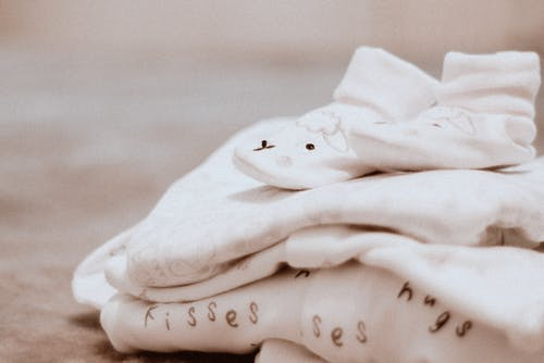 Pair of Baby's White Socks on White Textile