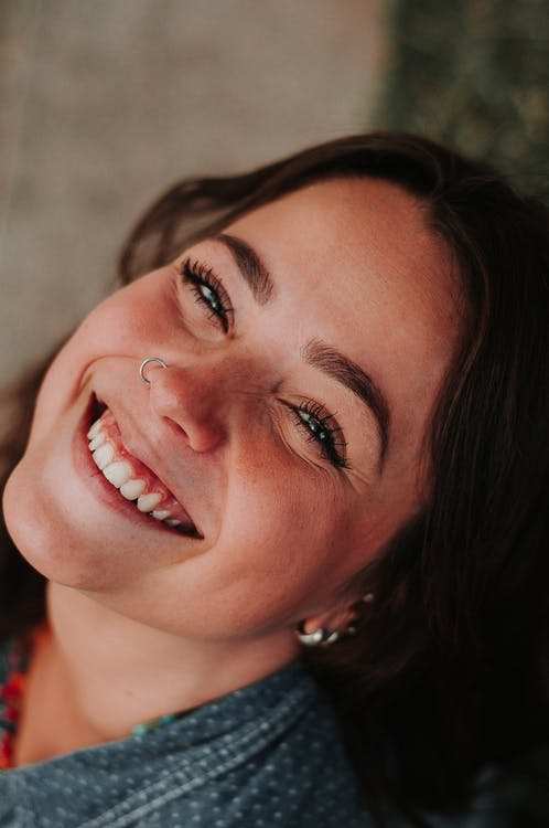Woman Smiling With Nose Piercing